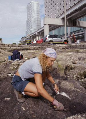 Anthropologist Dr. Alison Elgart-Berry searching for artifacts in downtown Miami